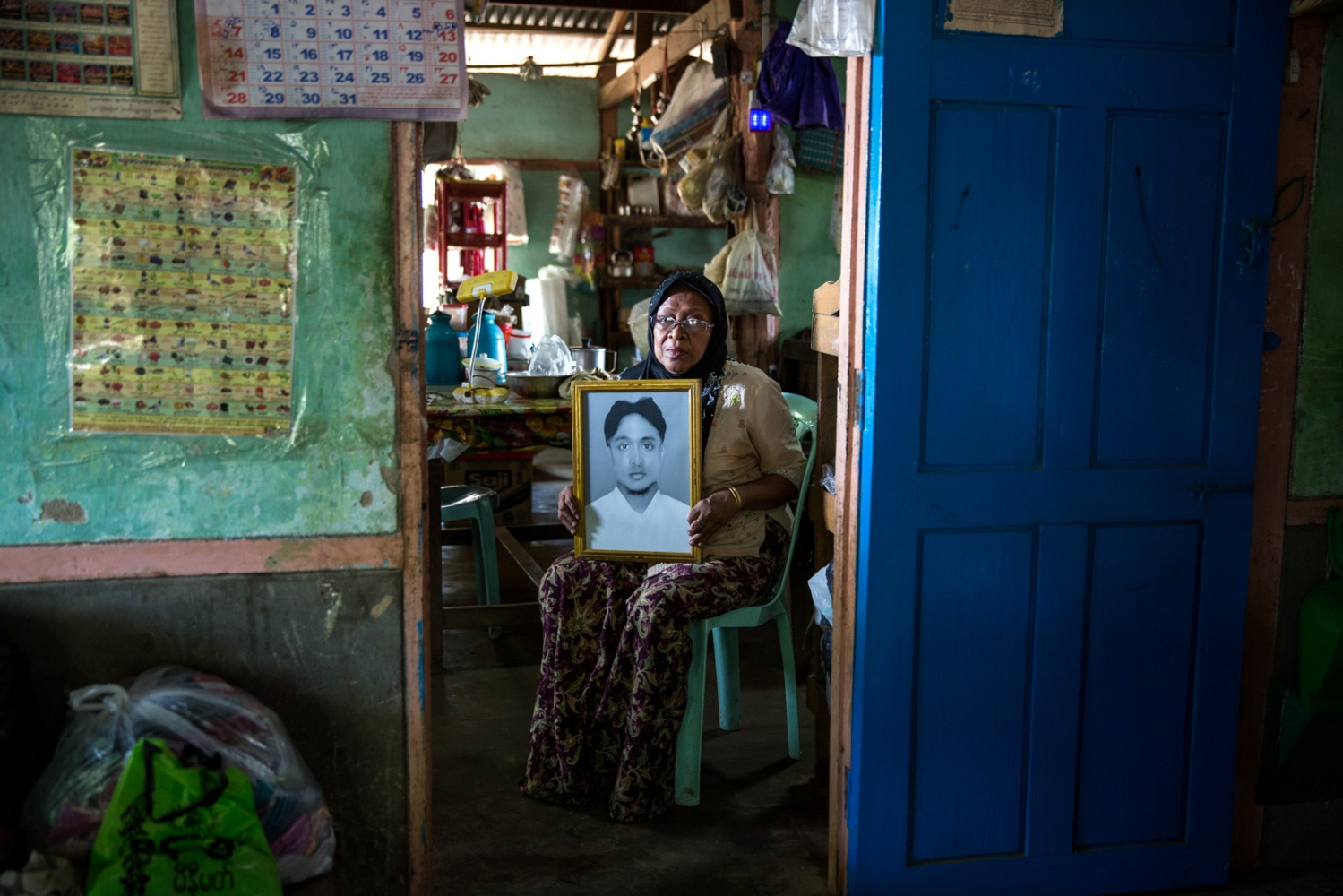 The aunt of arbitrarily detained Myo Min Naing, 32, holds her nephew's portrait. Myanmar military intelligence arrested Myo Min Naing, following his wedding in Kunhein, Shan State on August 9, 2014. On January 12, 2015, the Taunggyi District Court sentenced Myo Min Naing in a trial that failed to meet fair trial standards to 14 years' imprisonment with hard labor under sections 5(J) and 5(L) of the 1950 Emergency Provisions Act. In October 2016, the Myanmar government repealed the notoriously controversial 1950 Emergency Provisions Act, yet Myo Min Naing remains detained in Pathein prison under the now defunct Act.