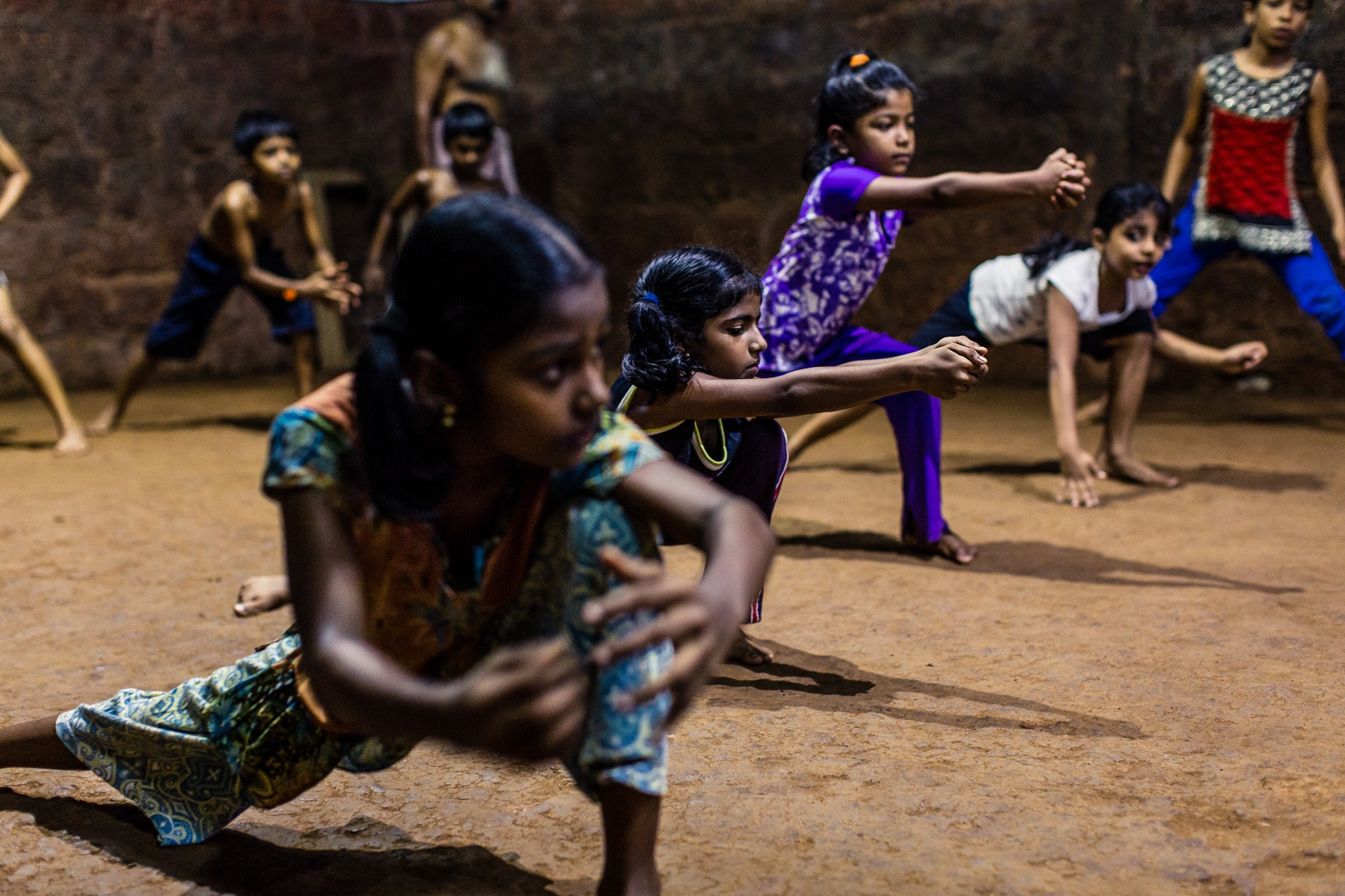 Vatakara, Kerala, INDIA - September 17, 2017: Female students practice 'Kalaripayattu' techniques. Since several rape cases in India received extensive media coverage and triggered protests in 2012, more young women have begun training at the school and an increasing number of parents allow their girls to train Kalaripayattu. Nowadays, one third of Meenakshi's students are females aged between six and twenty-six.