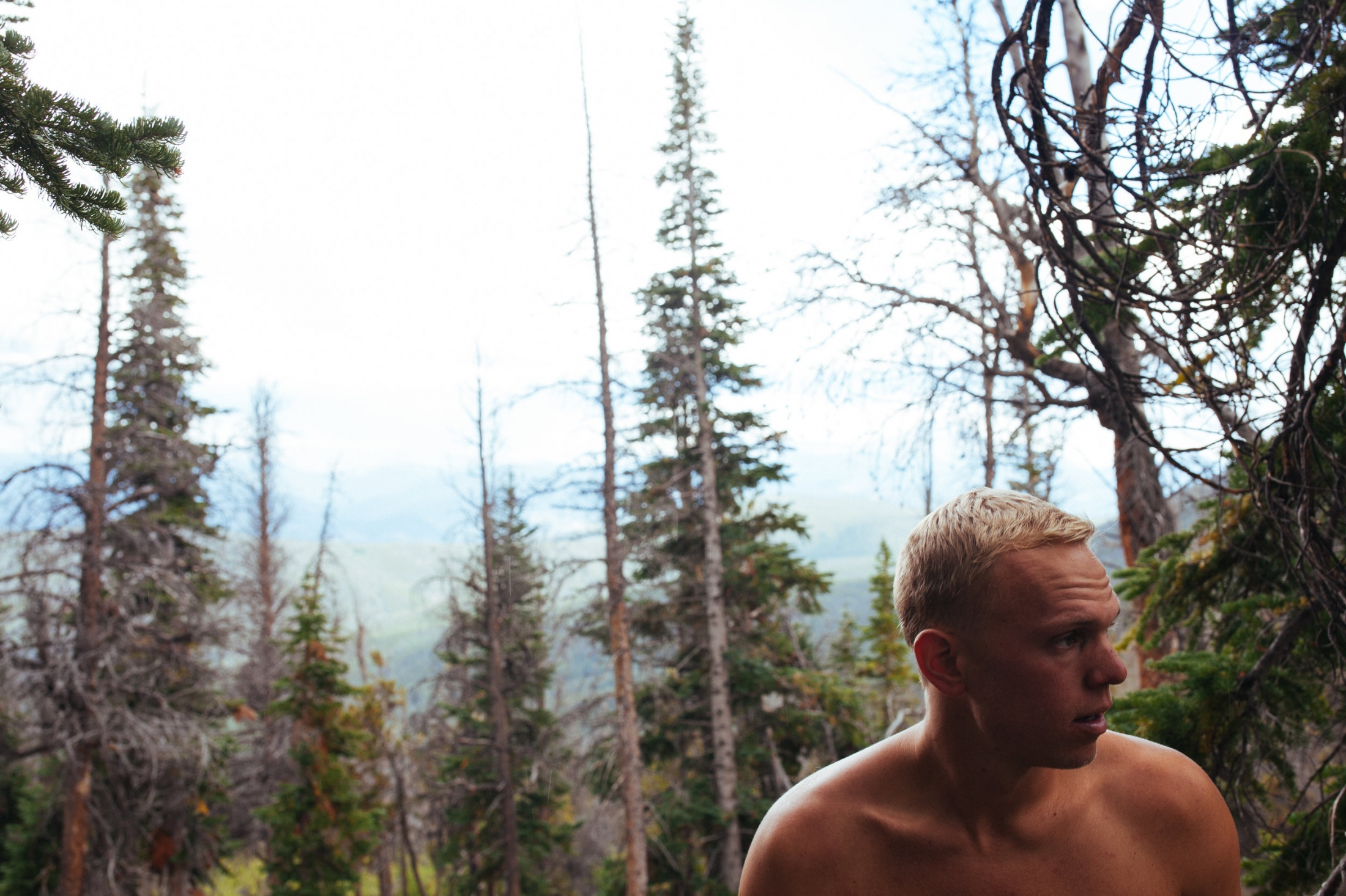 Taylor seeking shelter from the thunderstorm over Mount Royal, White River National Forest, CO.