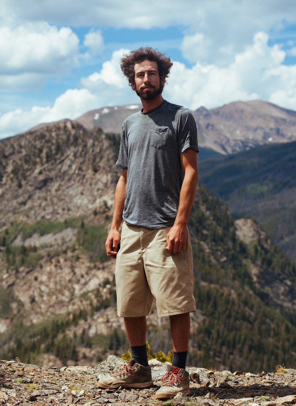 Portrait of Logan at the end of a long hike. Just minutes after we all hid under the tree line as a thunderstorm rolled over Mt. Royal (10,502 feet), White River National Forest, CO.
