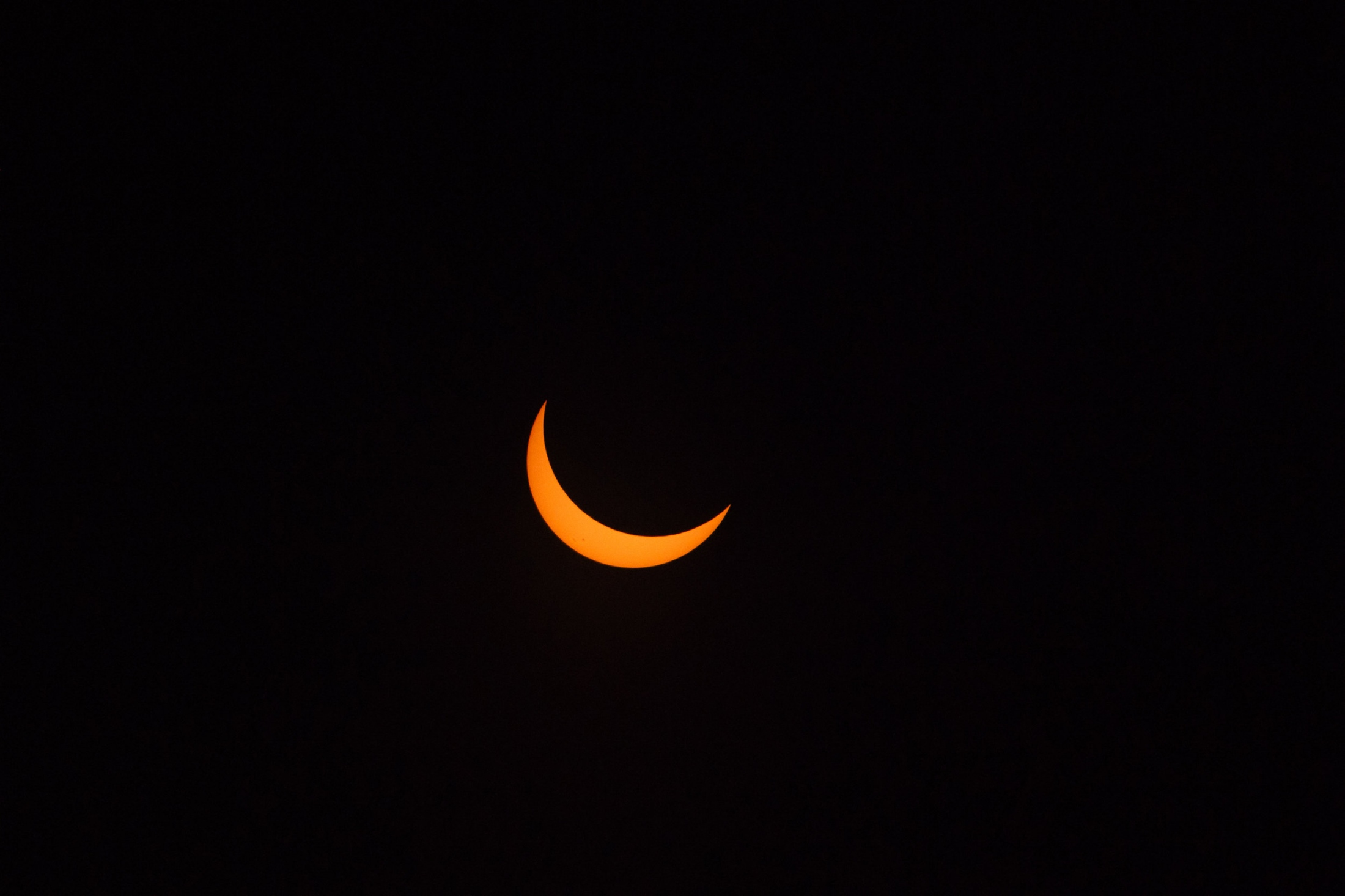 Solar eclipse moments before becoming a total solar eclipse, Payette, ID.