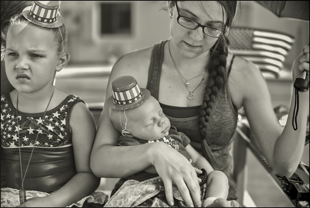 First 4th of July. Mother her two week old and her young cousin prior to parade in Benson, Arizona. July 4, 2018