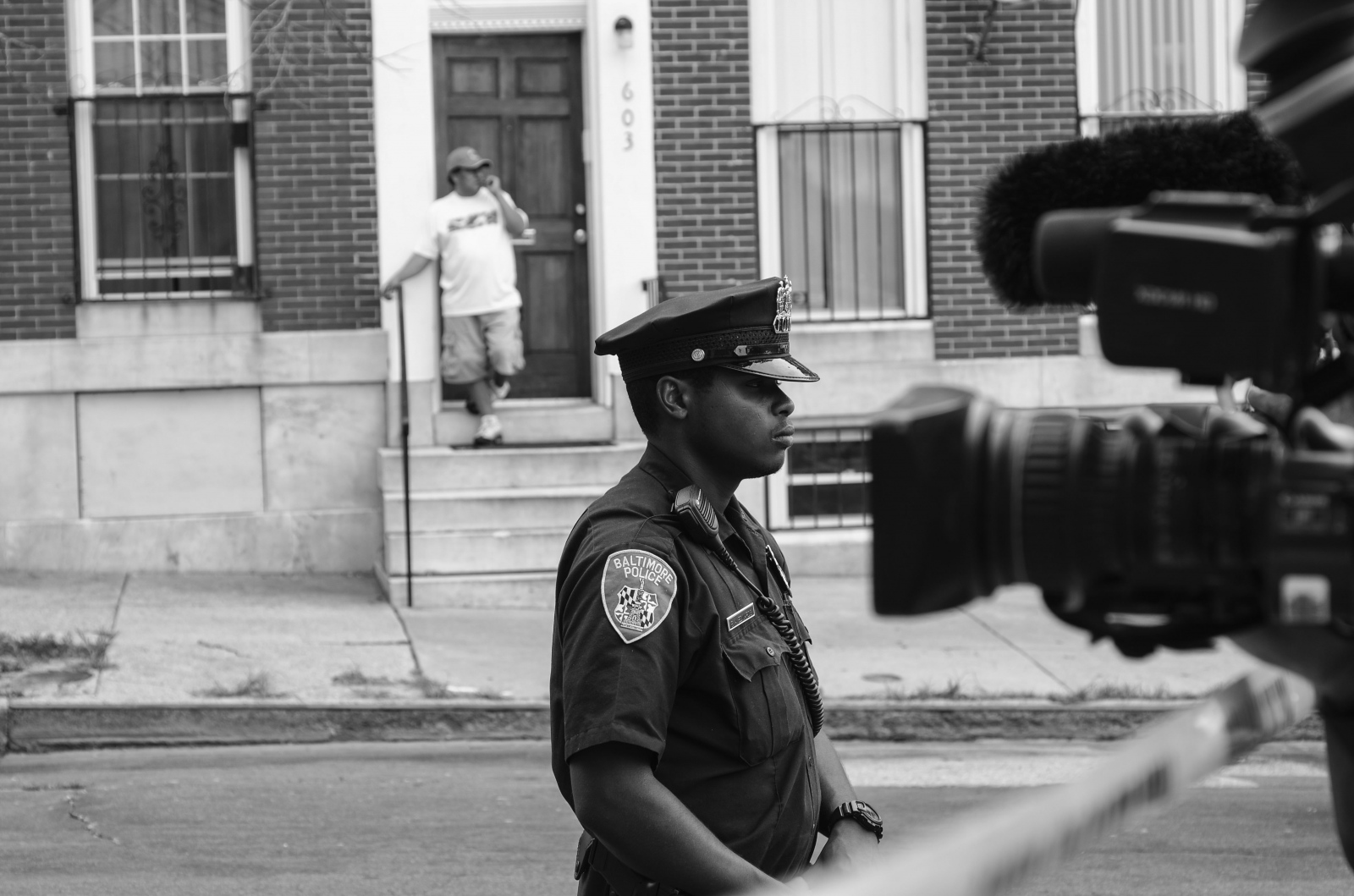 Media cameras point at police  following a triple shooting in the 600 block of S. Carrollton St. on June 9, 2013
