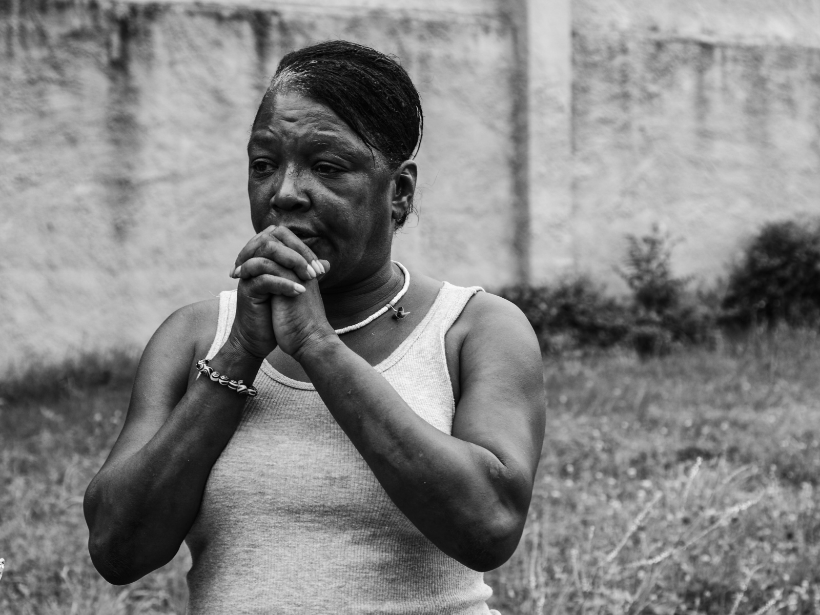 """I pray everyday for the violence to stop,"" says a neighbor following a triple shooting in the 600 block of S. Carrollton St. on July 9, 2013."