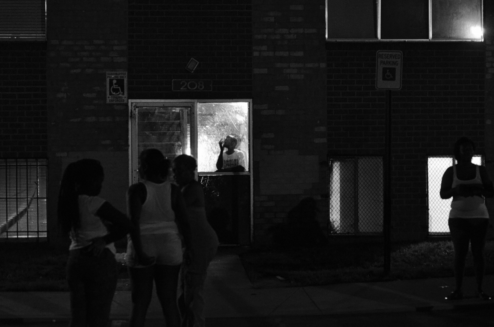 Neighbors gather at the site of Montae Harris' shooting in Northwest Baltimore. July 15, 2013