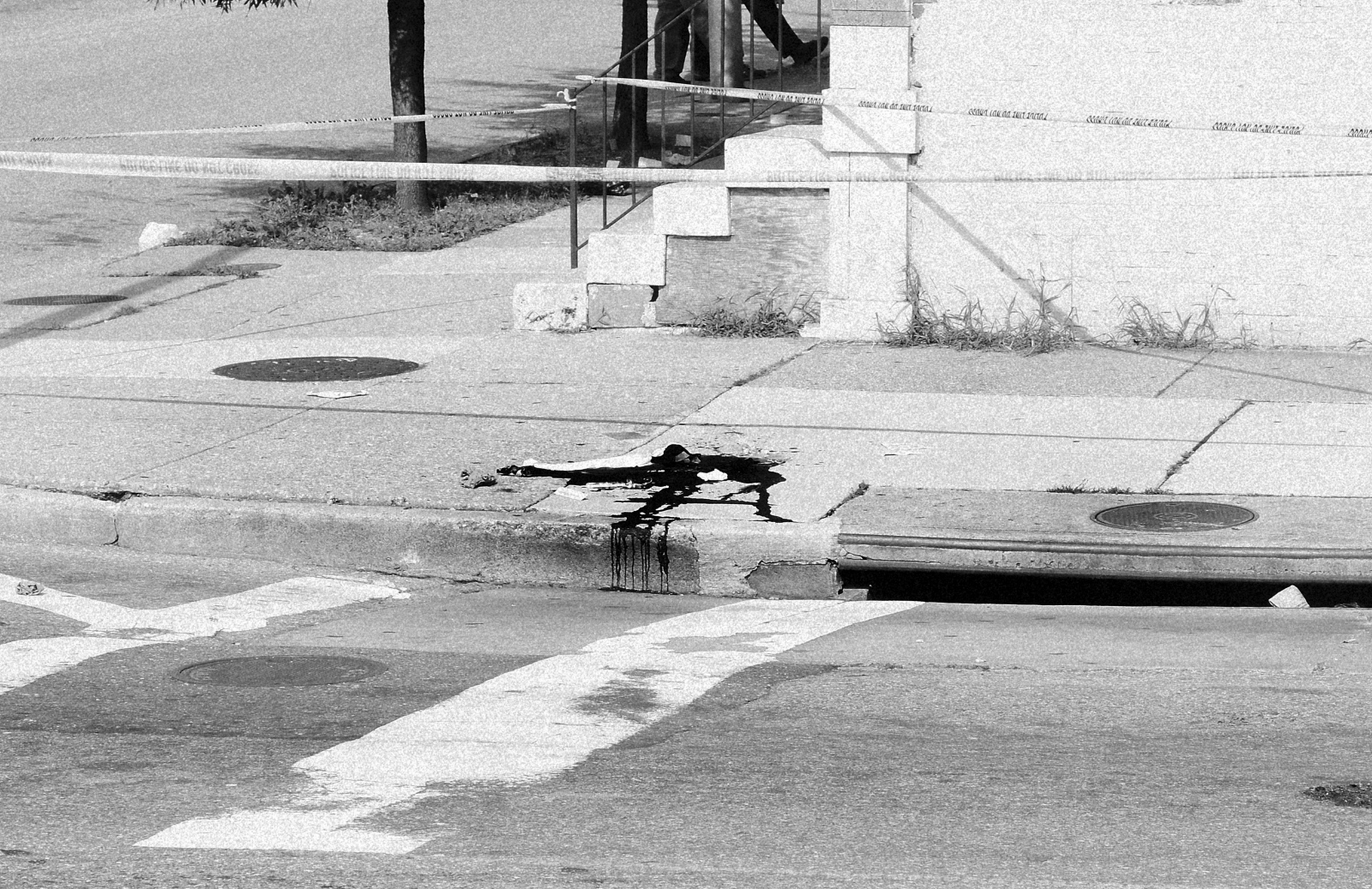 Remains of a shooting between a 12-year-old and an elderly man at the corner of Preston and Milton avenues in E. Baltimore. July 22, 2013.