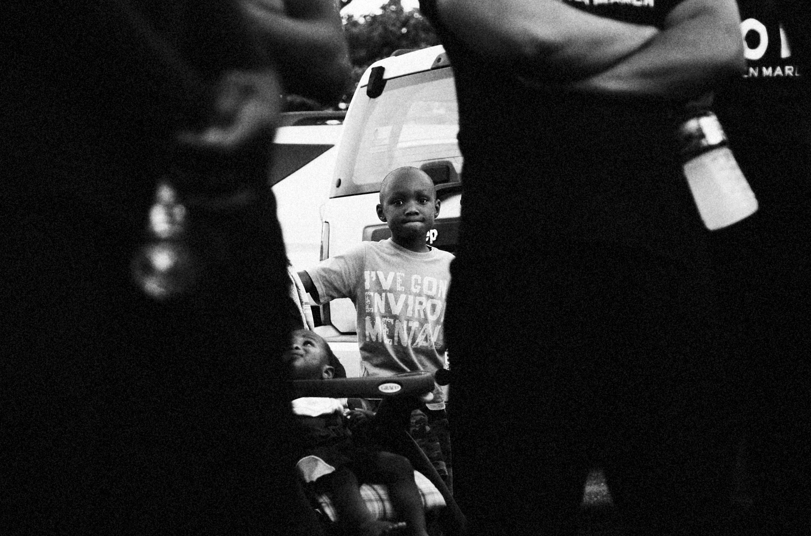 In response to the spike in homicides in 2013, Baltimore City Councilman Brandon Scott and activist Munir Bahar organized the 300 Man March, which encouraged men of all ages to walk at night through some of Baltimore's most violent neighborhoods. Neighbors came out fo their houses to cheer the marchers on as they walked through Baltimore's BelAir-Edison neighborhood.