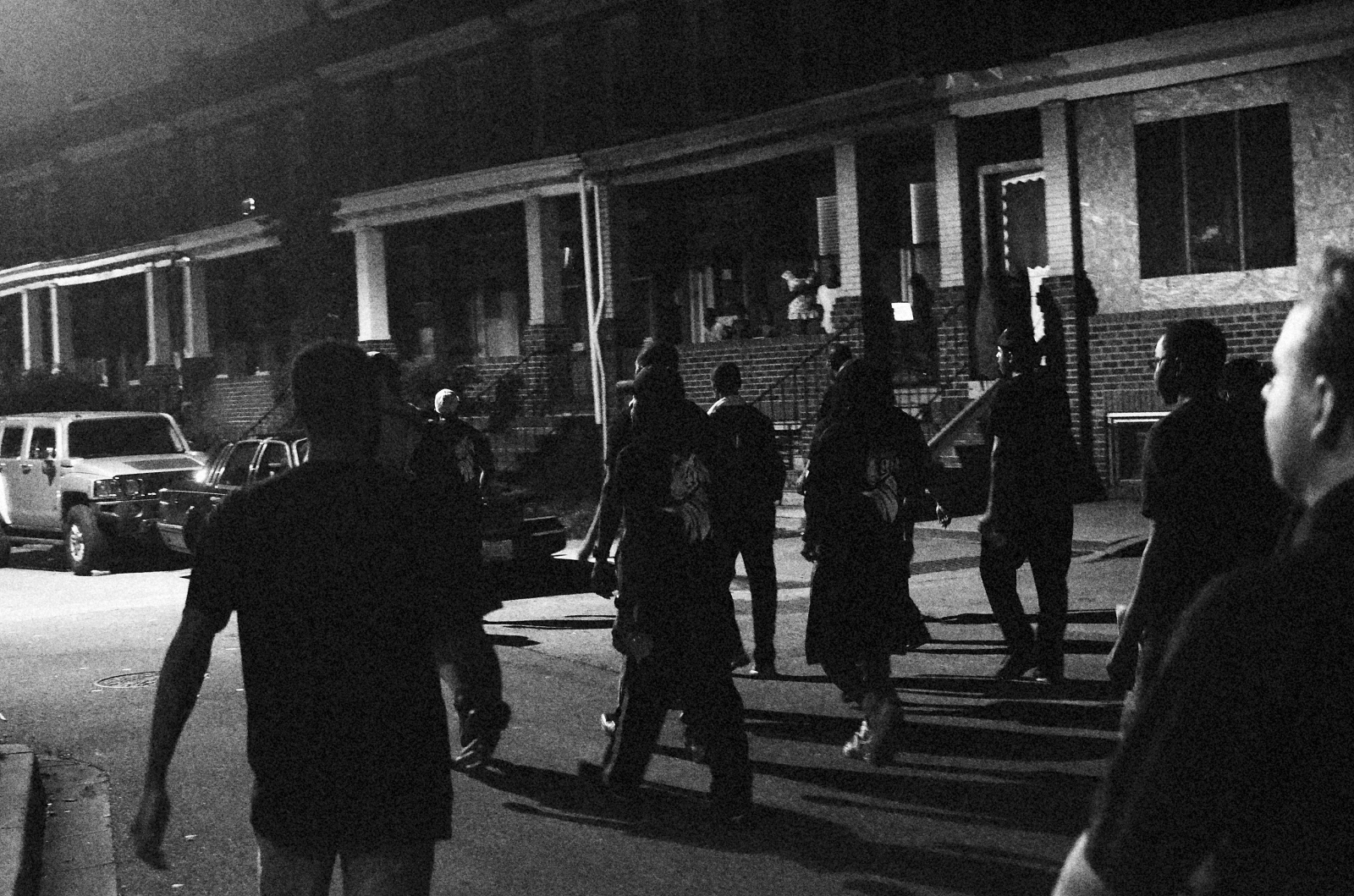 In response to the spike in homicides in 2013, Baltimore City Councilman Brandon Scott and activist Munir Bahar organized the 300 Man March, whiich encouraged men of all ages to walk at night through some of Baltimore's most violent neighborhoods. Marchers walk through a neighborhood in East Baltimore on August 2, 2013.