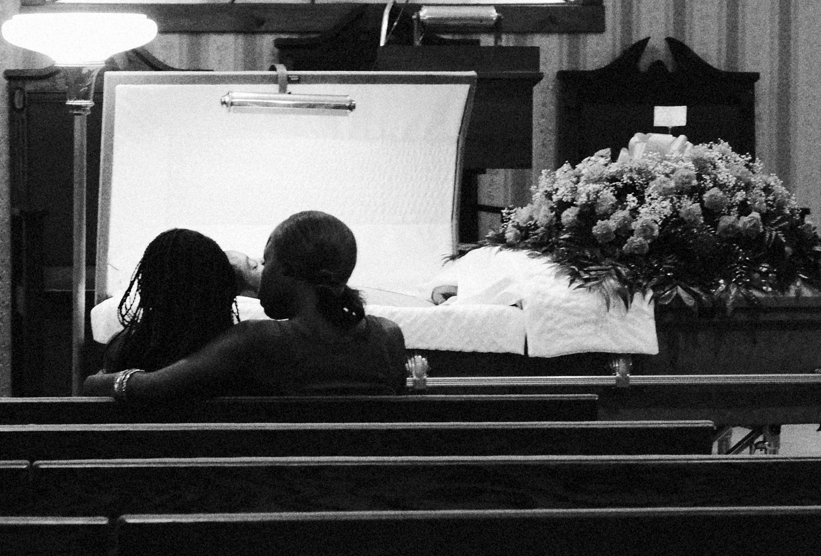 Mourners at the funeral of Davon Ockimey who was gunned down in the 1400 block of Pimlico Road on July 2, 2013,