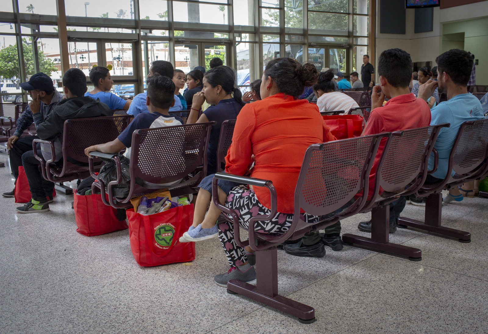 Migrants who were released from detention and were given comfort and aid by Catholic Charities and given help to find their families throughout the United States are also given bus tickets that will take them across the country to be reunited with their families who are already in the U.S.( Kevin C Downs/Agence Cosmos)