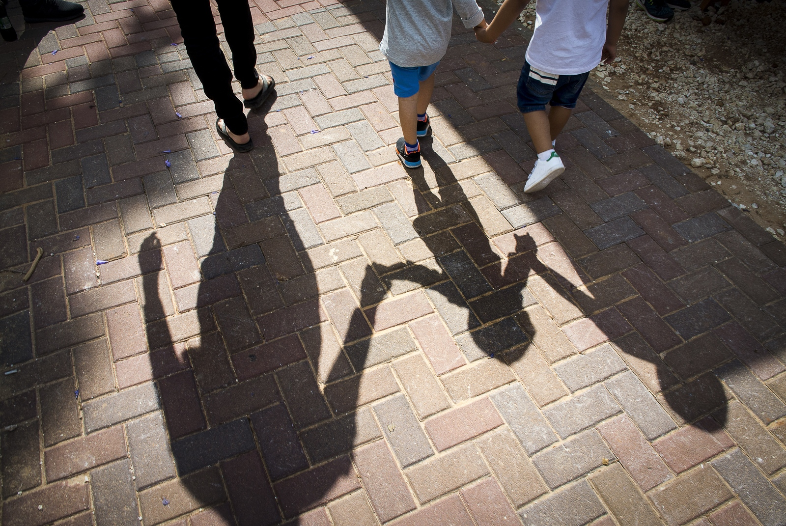 Mixed Arab and Jewish kindergarden children walking with in the grounds of the Hand in Hand Kindergarden at Beit Berl, Israel.
