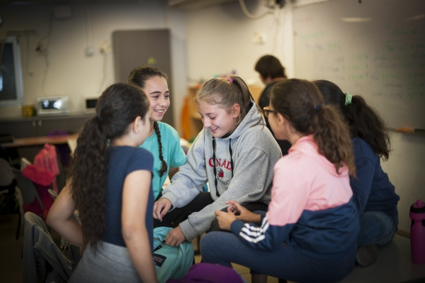 Arab and Jewish students mingle together during break time at the Jerusalem campus of the Hand in Hand School.