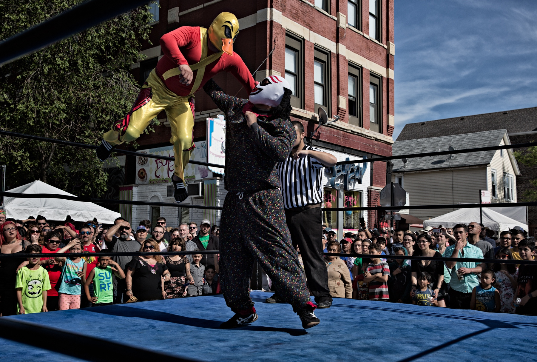 In a duck costume and only making quacking noise, Kung Fu Pato jumps from the ropes against a his opponent, a member of the Los Pyasos.