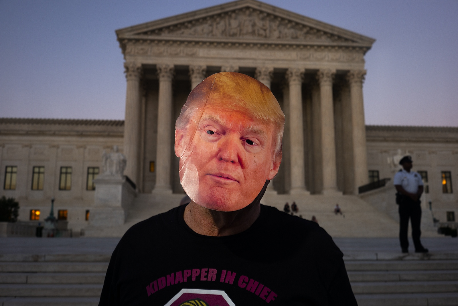 A protester in a Trump mask attends a rally in front of the U.S. Supreme Court building before Brett Kavanaugh was nominated to the court.