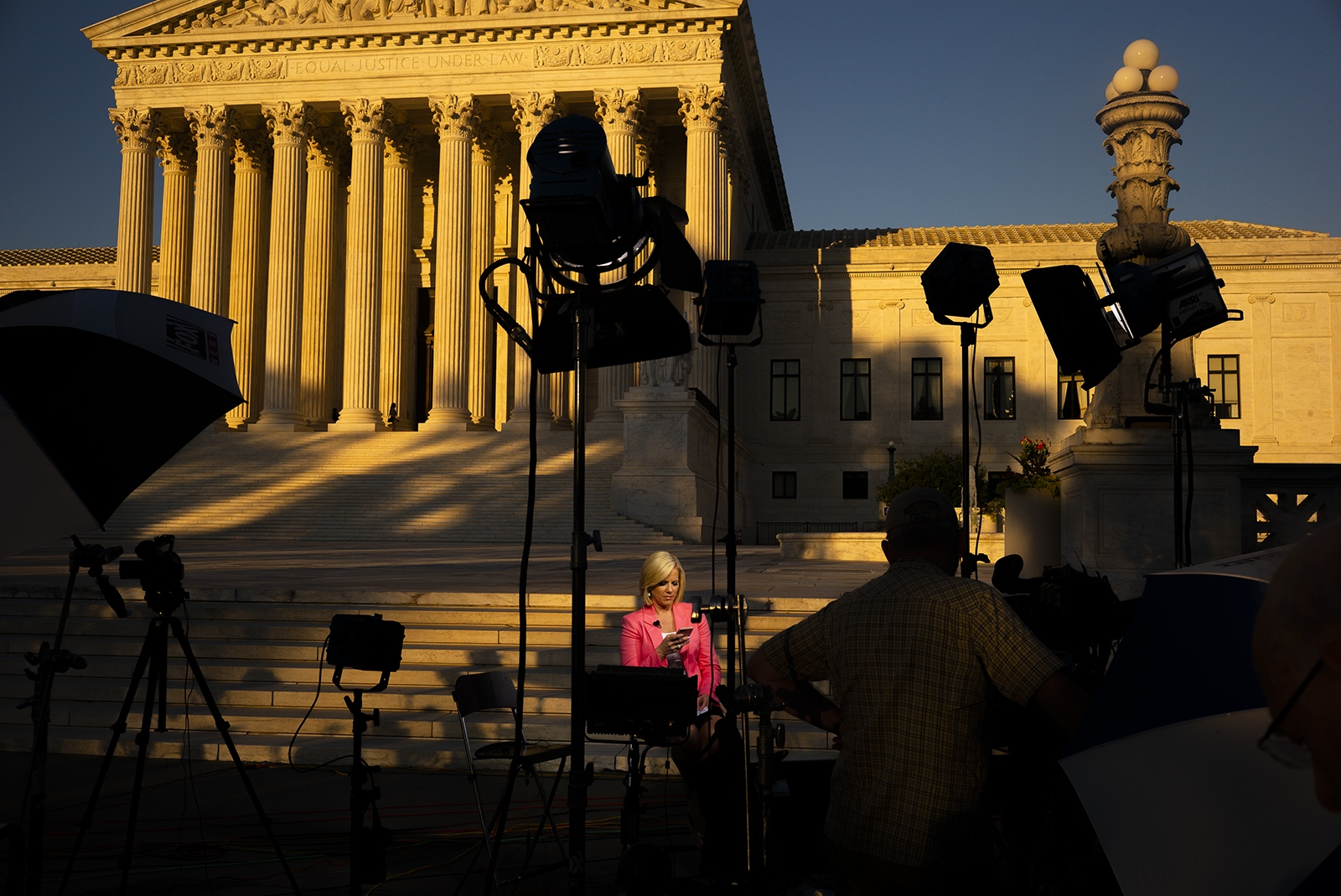 "Fox News host Shannon Bream waits for the SCOTUS nomination announcement. Bream's live show was canceled because as she stated in a tweet, ""The mood here tonight is very volatile.""  The scene became loud and a few people were in each other's faces but the mood was on par with every anti-abortion / pro-choice rally I've scene on the Supreme steps."