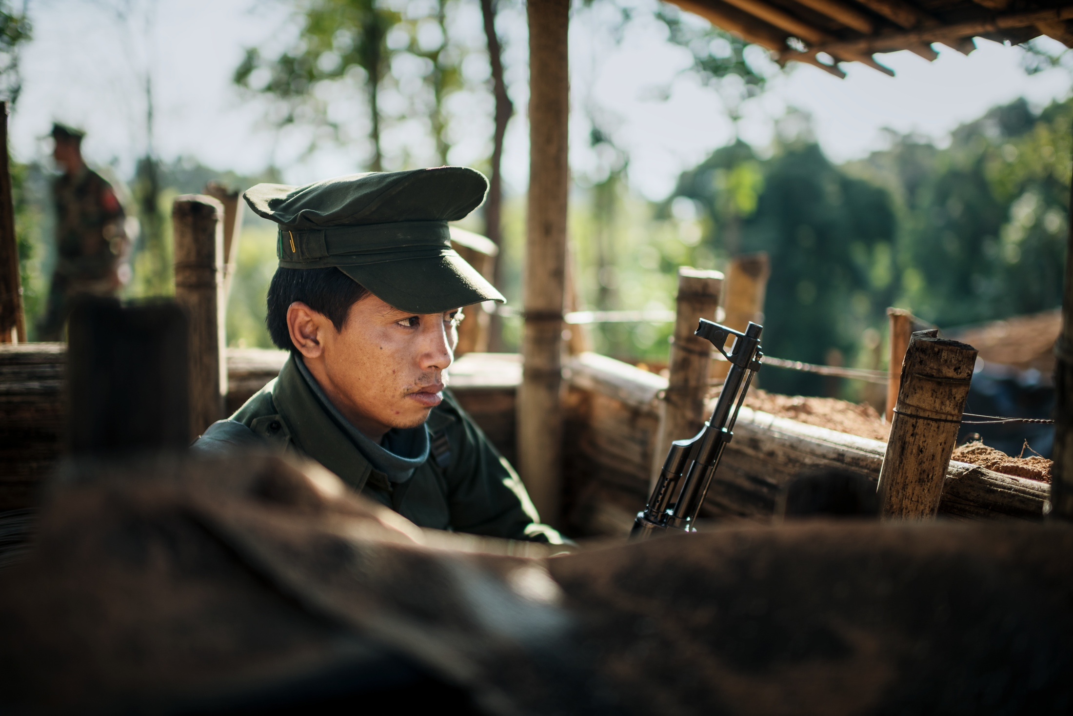 A KIA soldier watching the outer defences of one of the KIA Mobile Brigade outposts, just 1 km away form the closest Burma Army outpost.