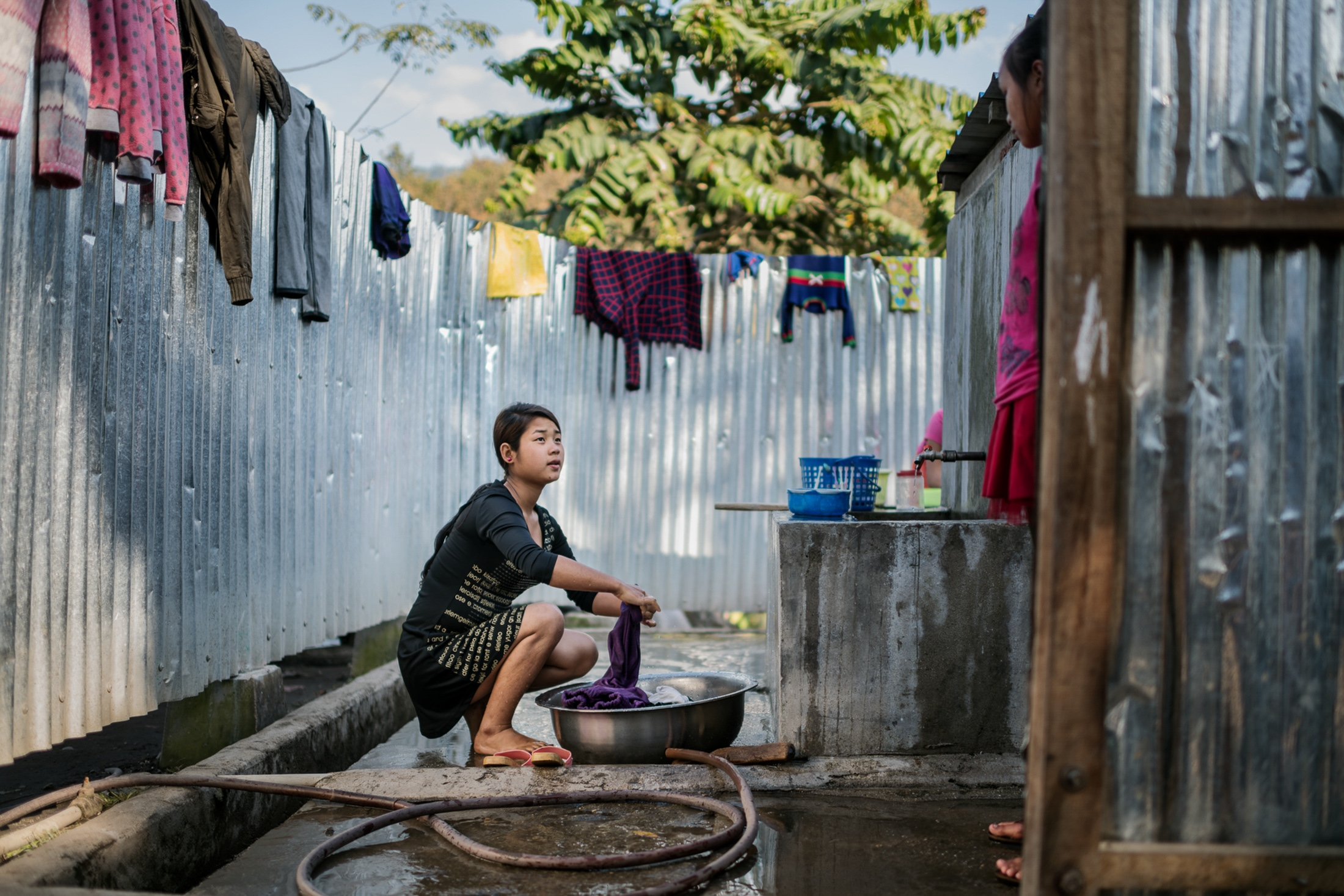 Seng Mai, 16, dropped out of school last year, and is now helping her mother more around the house in Je Yang IDP camp. She says she got tired of school, but that she will go back to school next year.