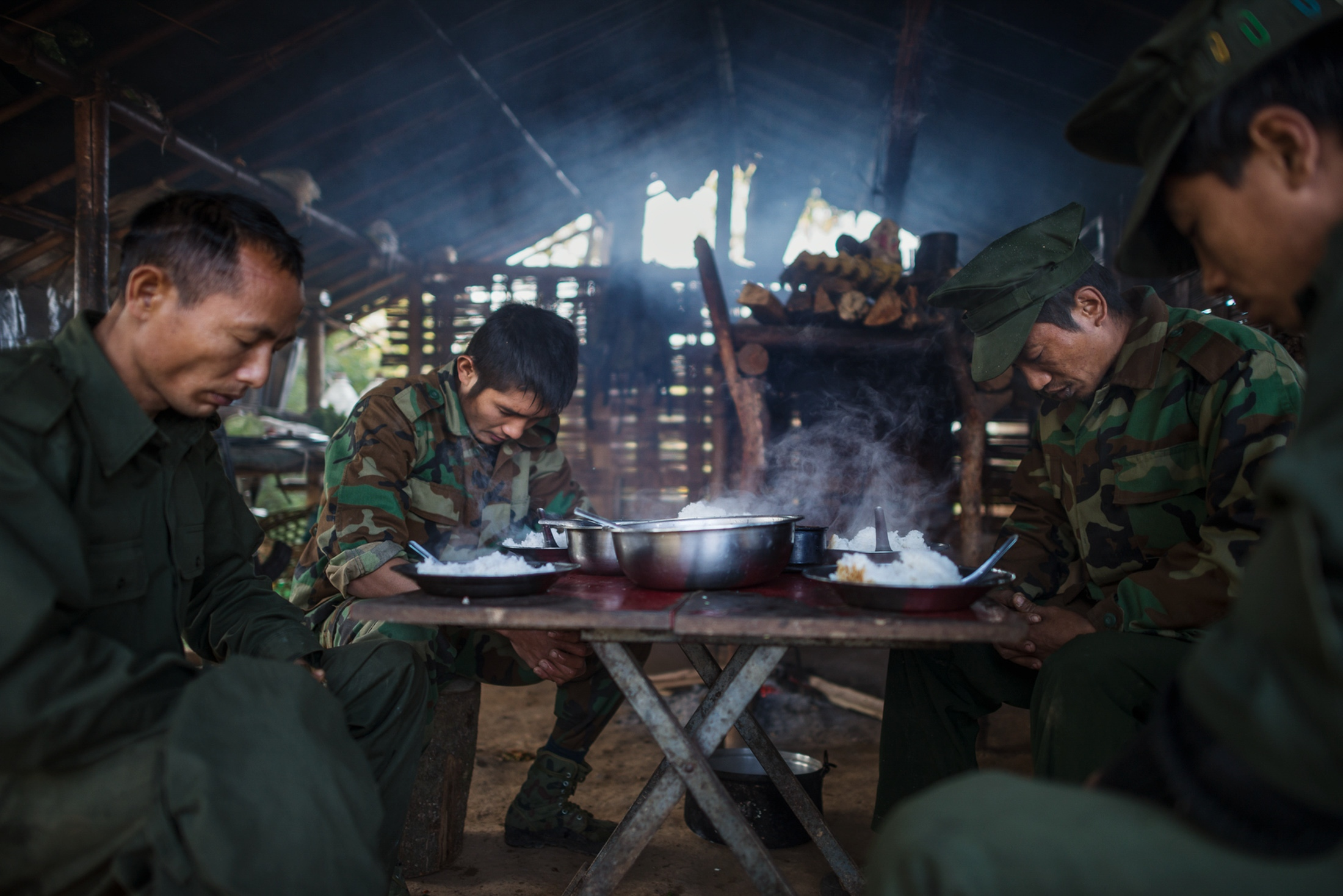 Byuwa Yaw Han, Aung Lun, Naw San and Aung Lat, of the Kachin Independence Army, saying grace before breakfast at a frontline outpost just 1 km from the Burma Armys nearest outpost.