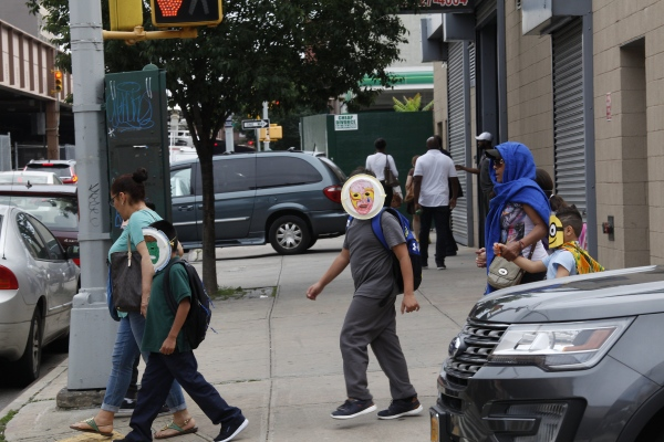 Migrant Children leaving the Cayuga Center at 1916 Park Ave in East Harlem wear masks to protect their identity, Manhattan, NY June 22, 2018(Kevin C Downs/Agence Cosmos)