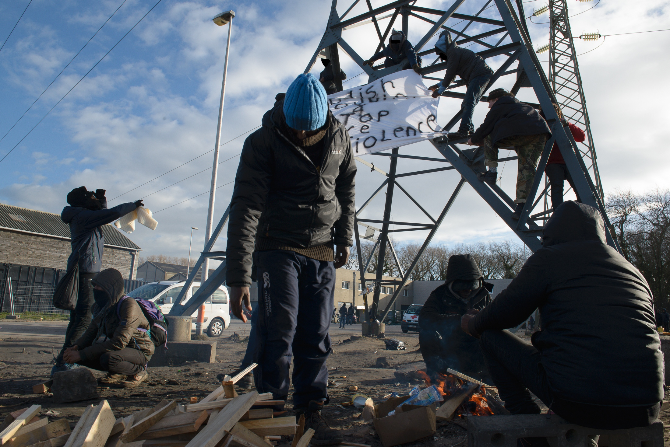 January 16, 2018 - Calais, France. During the visit of French President Emmanuel Macron to Calais homeless migrants living in the Jungle in Calais hung banners and published a joint statement on Facebook to denounce police violence towards them, ask for the end of the Dublin Act and for borders to be open.