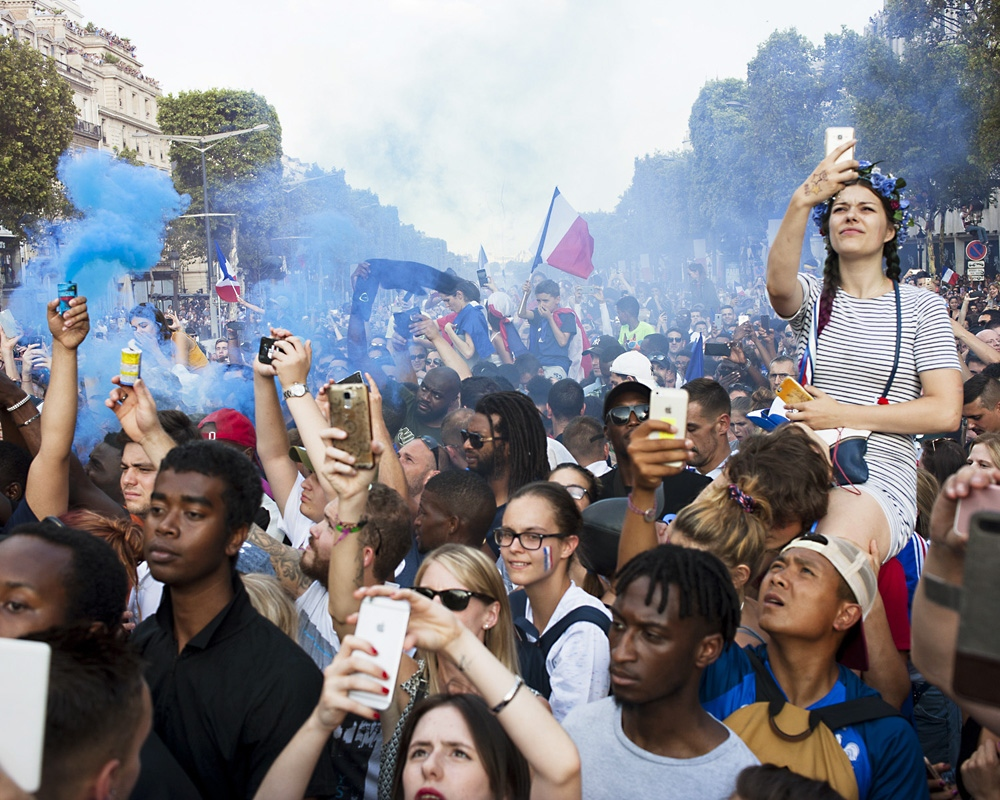 Fans capture the French team at the Champs Elysée avenue in Paris