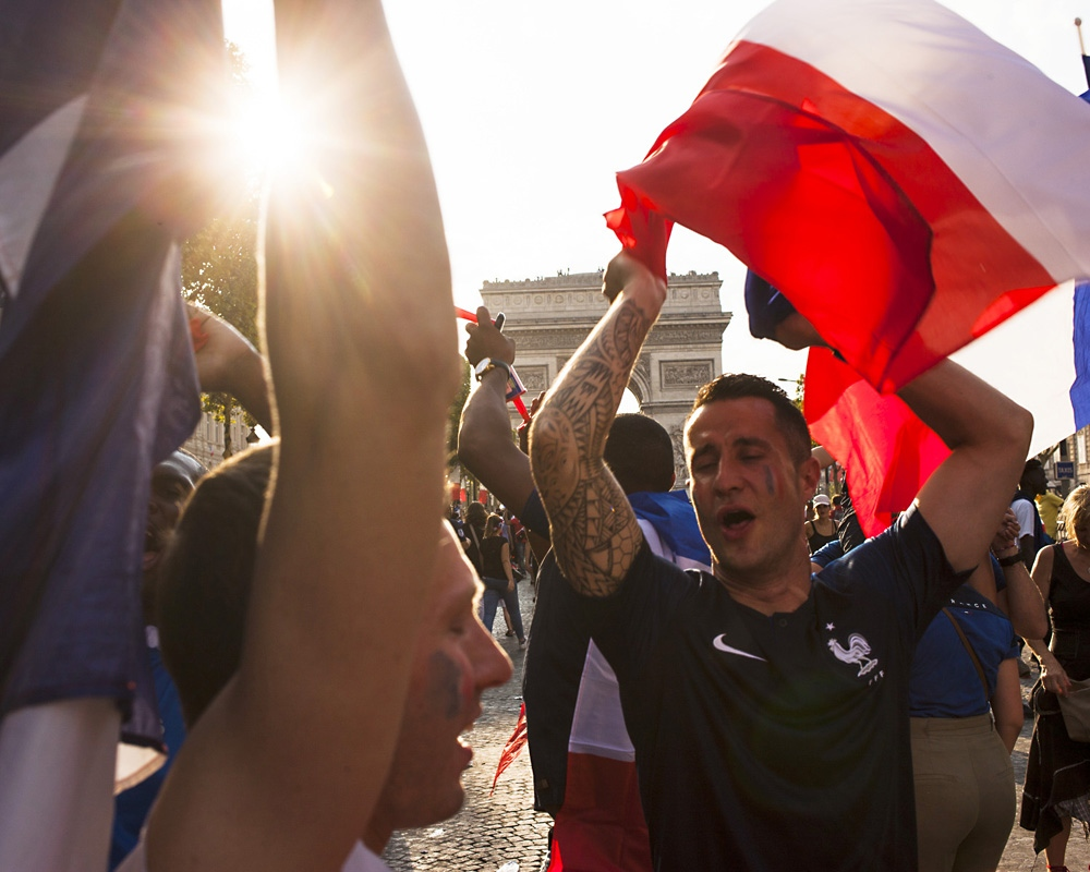 Fans celebrate the French team at the Champs Elysée avenue in Paris.
