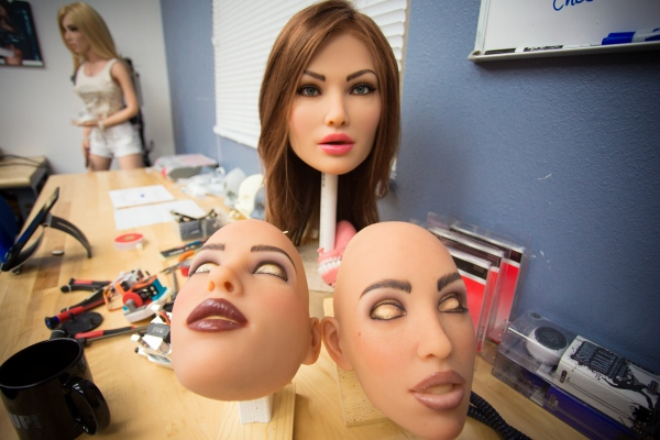 The love dolls and robots are life size. Here, an employee is getting her ready for shipment.