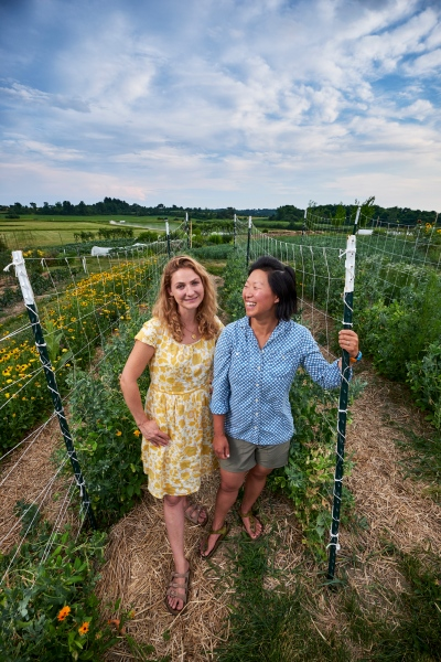 Megan O. Brakeley and Sophie Esser Calvi at The Knoll, Middlebury College's organic farm.