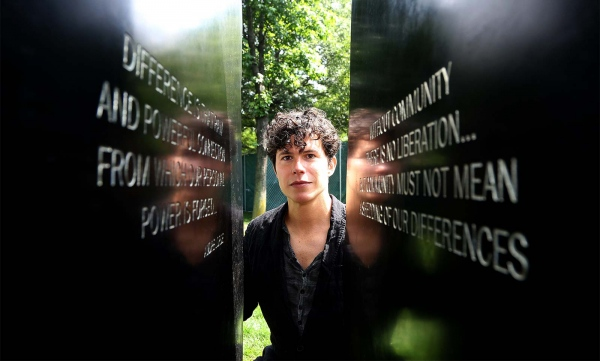 Sculptor Anthony Goicolea next to his LGBT Memorial Honoring Victims of Hate, Intolerance and Violence at the Hudson River Park.