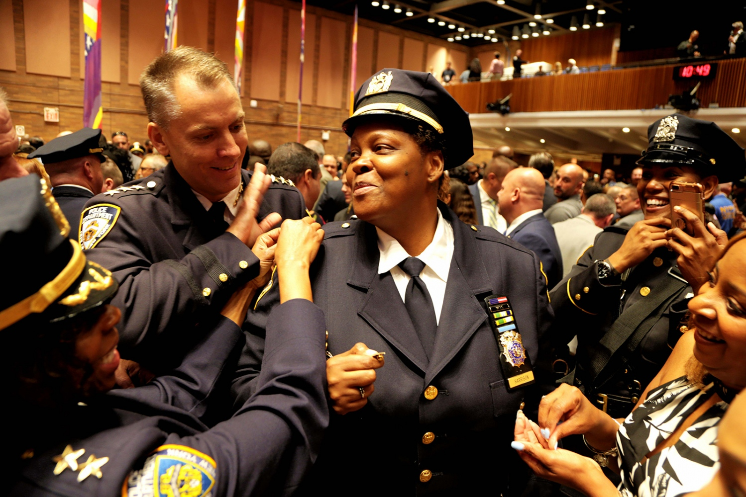 NYPD Deputy Chief Judith R. Harrison is all smiles and surrounded by colleagues after being promoted during ceremony at Police Headquarters in downtown Manhattan.