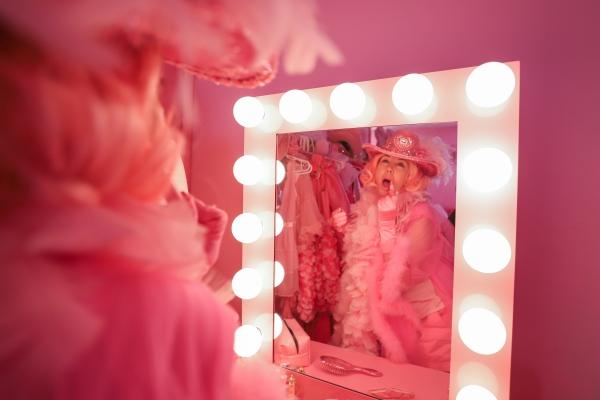 Kitten Kay Sera putting on a certain shade of pink lipstick.