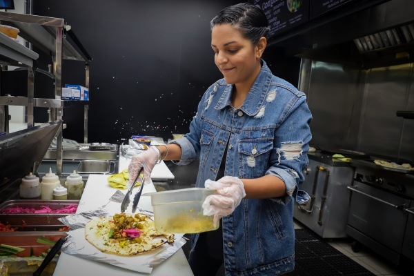 Priyanka Mac helping out in the kitchen.