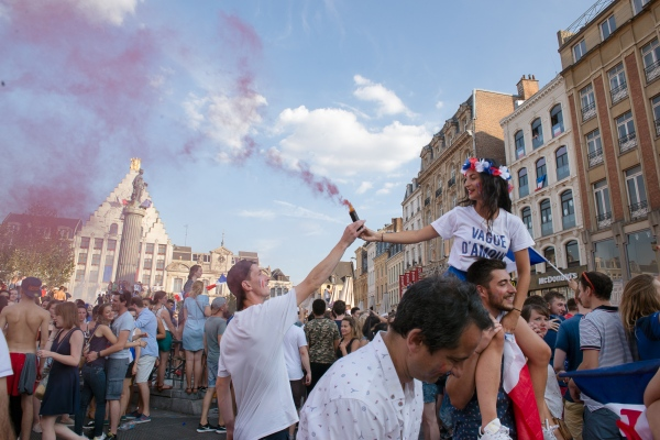 People gathered in the street after the French soccer team won the FIFA World Cup.  Lille, France -  July 15, 2018 .