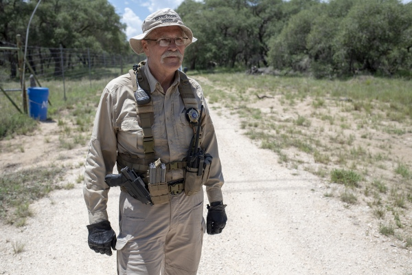 Eddie Canales is in his truck driving volunteers and water to replenish sites that house water for immigrants. He, along with volunteers from the South Texas Human Rights Center, located in Falfurrias, TX, also do searches for migrants who have died in the rugged ranch land of rural Brooks County, which is 70 miles north of the Rio Grande. He and his group of volunteers, with help from Benny Martinez, the sheriff of Brooks County, and Kate Spradley, from Texas State University's Forensics Anthropology Center, are trying to save immigrants and identify the bodies of the dead who did not make it through.