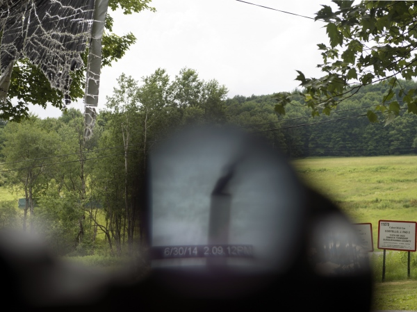 Rig Mosaic, 2016   The work combines a high resolution image of a shale gas drilling rig in Rome, PA, with 1764 low resolution images captured by a wildlife camera mounted to record truck traffic during shale gas operations in Brooklyn, PA. Truck images provided by Frank Finan.