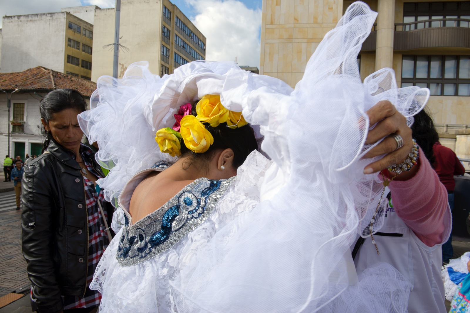 (EN) May 17, 2018 - Bogota, Colombia. A dancer from the Agrupación Artística Tierra de Promisión from Neiva is getting ready to perform during the closing rally of the Colombian presidential candidate Gustavo Petro. (ES) 17 de mayo, 2018 - Bogotá, Colombia. Una bailarina de la Agrupación Artística Tierra de Promisión de Neiva se arregla para la presentación durante  el cierre de campaña del candidato a la presidencia Gustavo Petro.