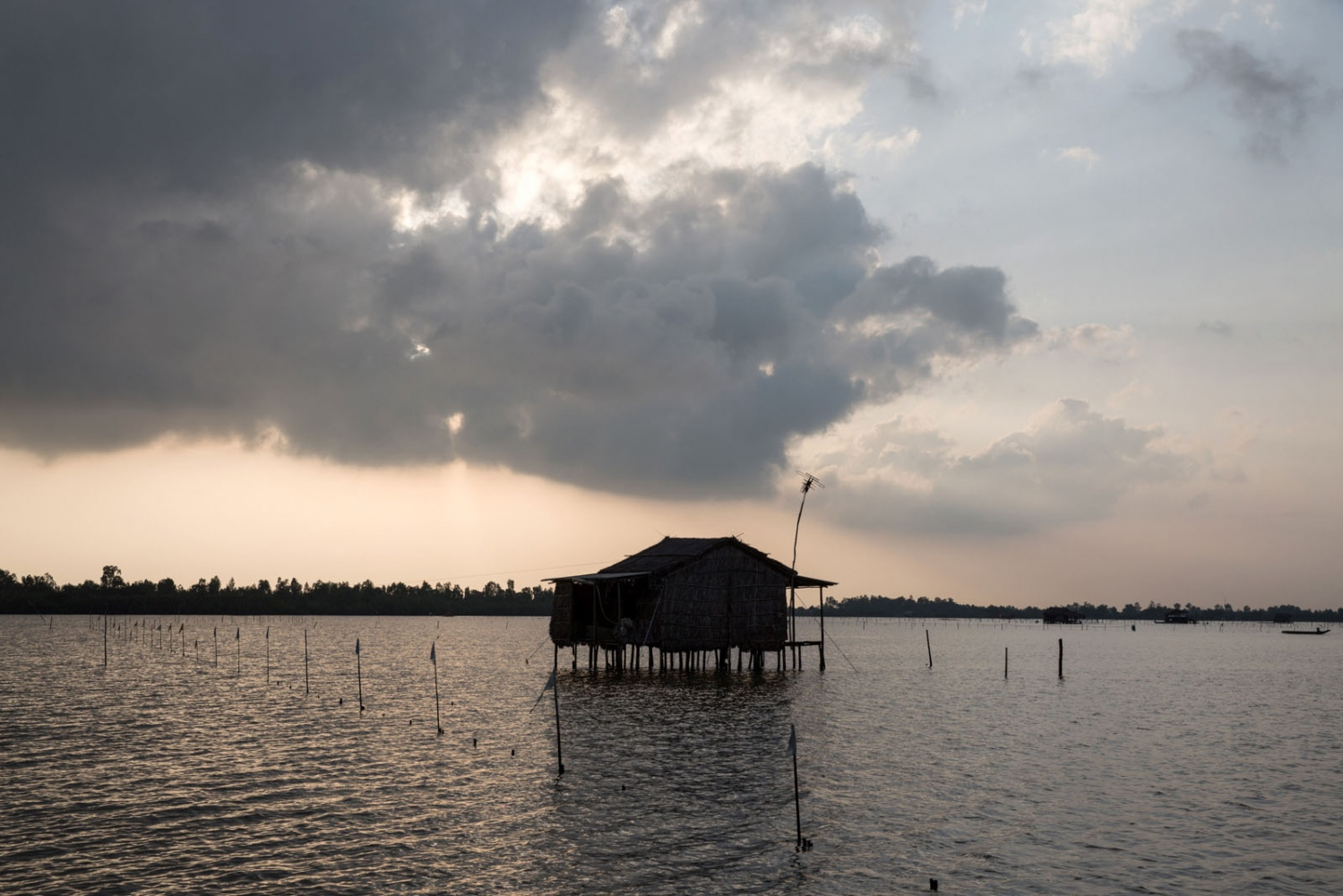 A fisherman's house on stilts in the middle of Thi Tuong Lagoon in Ca Mau Province. 2km wide and over 10km long it is the largest natural lagoon in the Delta and an important for the hundreds of fishermen and families who rely on it.