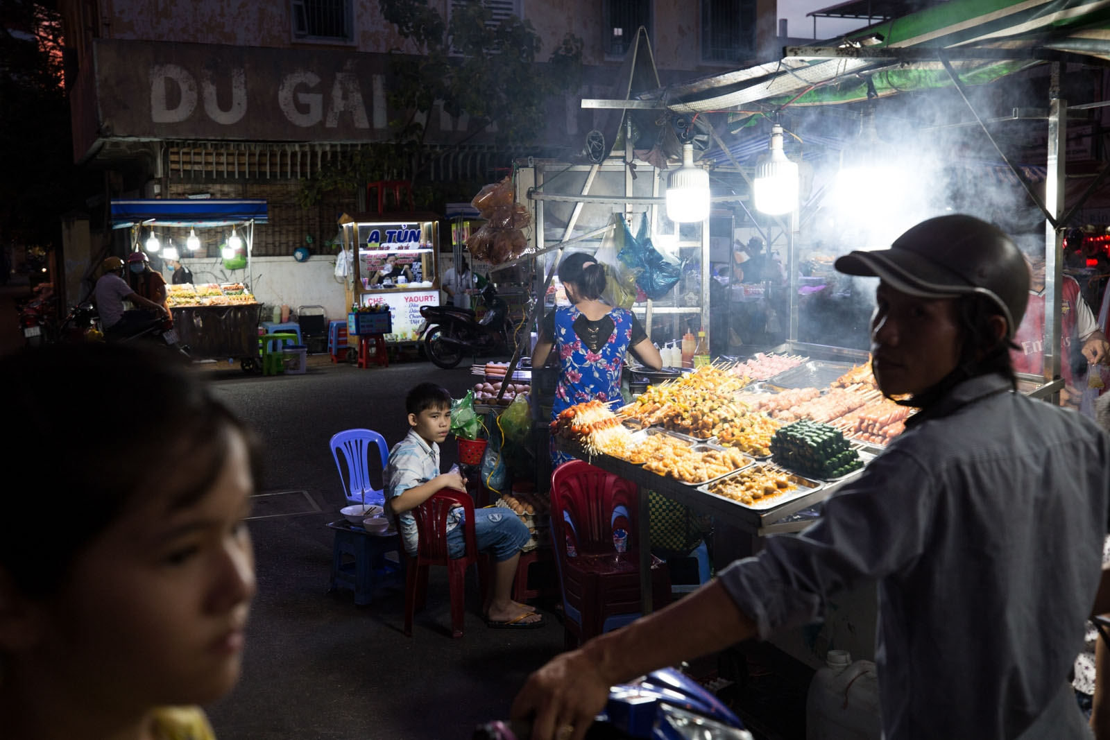 At an evening food market in Can Tho city, customers arrive on motorbikes to buy freshly made food. This growing affluence in the Delta has led to an increase in the demand for electricity which in turn has led to ill-conceived development projects to try to meet that demand, ultimately putting increasing pressure on the natural environment.
