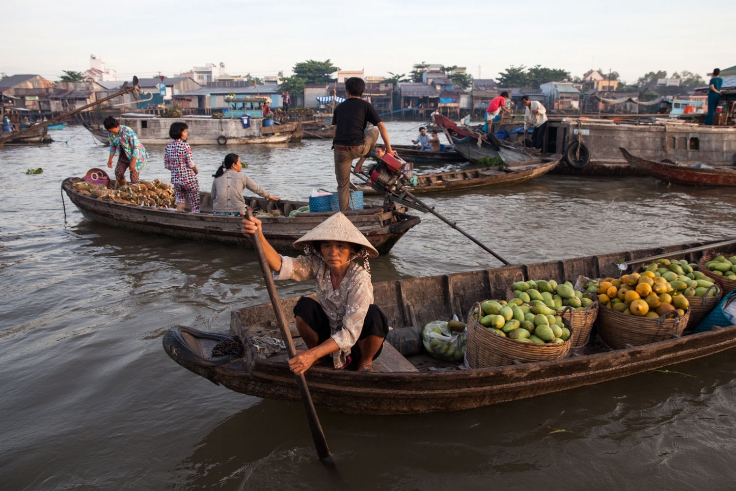 The most iconic scenes of the cultural life on the Mekong Delta is that of the floating markets that exist on the rivers. Here at Cai Rang floating market in Can Tho city, the largest floating market in the Delta, fruit vendors are busy trading at dawn. Unfortunately, scenes like this are becoming rarer and rarer as the popularity of floating markets by local vendors declines. This is due to improved infrastructure in the form of roads and bridges which they prefer for their speed and ease of use.