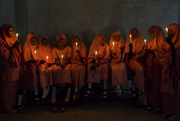 Title: School girls with candles (1) Series: Tatsuniya (2017) Dimensions: 68.5 cm x 101.5 cm  Edition of 7 Materials: Digital print on archival paper Availability:  Enquire with Red Hook Labs, NY   https://www.artsy.net/artist/rahima-gambo