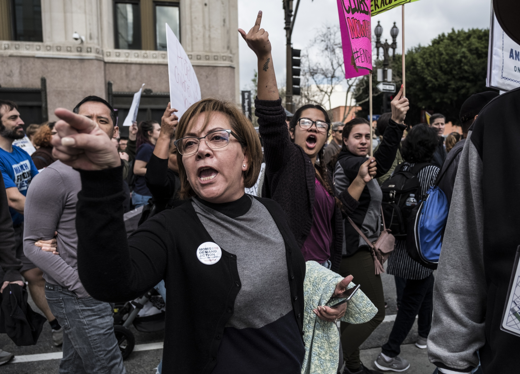 Activists react to a small group of pro-gun counter protesters during the March for Our Lives Los Angeles rally on March 24, 2018 in Los Angeles, California. More than 800 March for Our Lives events, organized by survivors of the Parkland, Florida school shooting on February 14 that left 17 dead, are taking place around the world to call for legislative action to address school safety and gun violence.