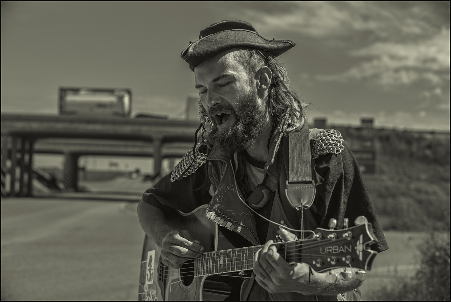 """Wolfie Wingnut"" singing for donations to purchase gas. Wingnut took up position at Exit 123 I40E on ramp in Seligman, Arizona USA. September, 2018."