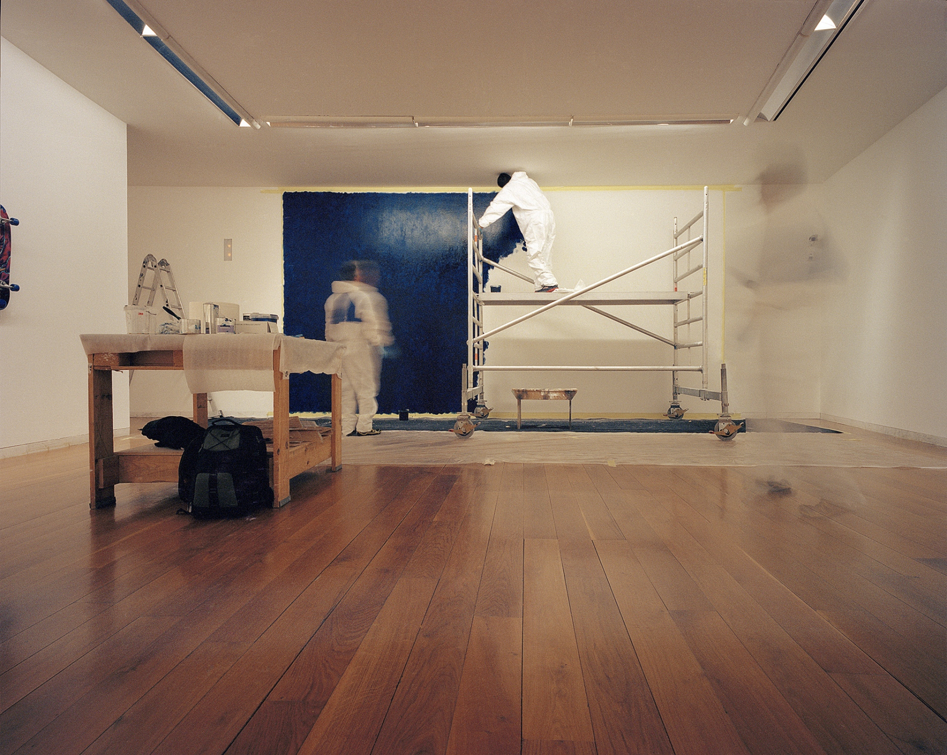 Graham Gussin working in CGAC, Centro Galego de Arte Contemporânea, Santiago de Compostela, Spain. 2014. The artist was invited by Miguel von Hafe Pérez , the former director and curator, to present a paint on a wall of the museum for the  Exposition 93 . This image was made with color film with a Mamyia 7II camera, in 6x7 format. It was scanned by the artist with Hasselblad flextight X1 professional scanner.  This has a edition of 6 + 3 PA  in the size 75x94 cm. It is printed by the artists in archival quality.