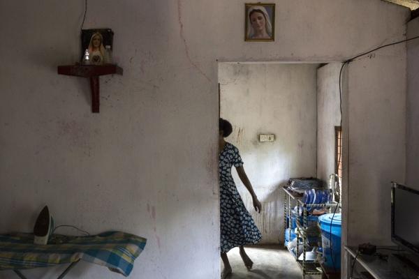Maria Jasintha, 45, cooks in the kitchen of her house in Sirambadiya village.  Siriambadiya, Sri Lanka