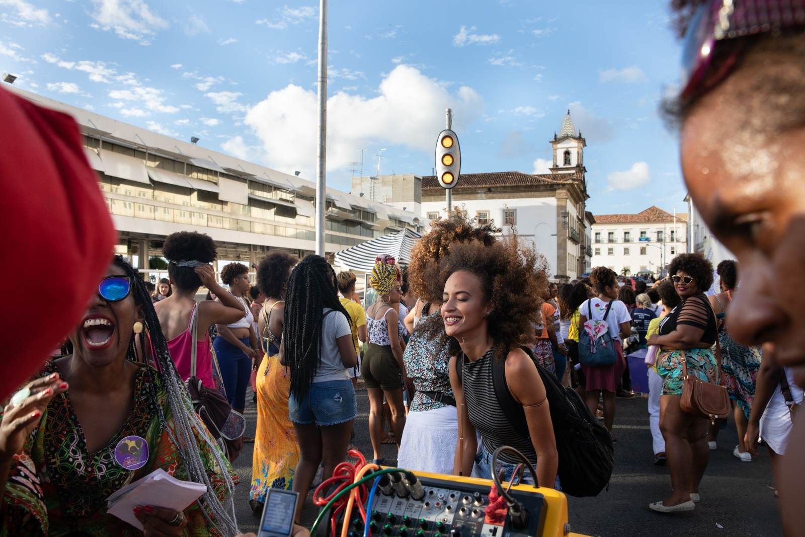 """A woman dances at the march for the International Day of the Black Latin American and Caribeam Women organised each 25th July together with the """"Mês das Pretas"""" (Month for the Black Women) in Salvador, Bahia. The Afro-feminism and feminism in Salvador is growing strongly and mouvements, events, conferences, activities are happening frequently in town. Last year, a turning point for the feminist militants and one of the most significant event for the mouvements in Brazil, was the Angela Davis conference talk at University of Bahia, whose visit gathered hundred of women."""