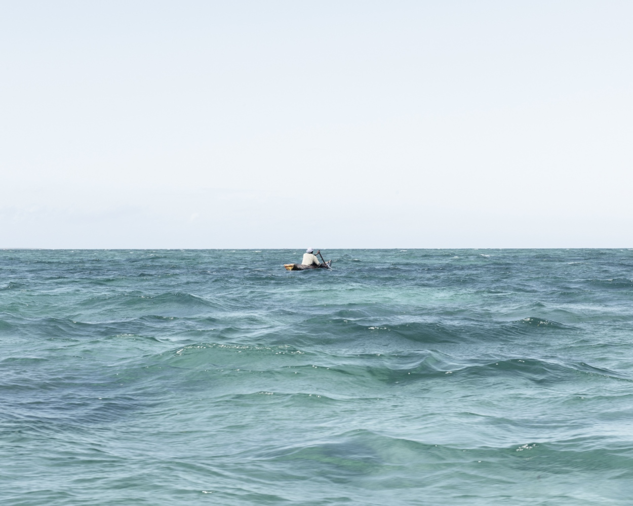 A divers goes home after retrieving some Sea Cucumbers.