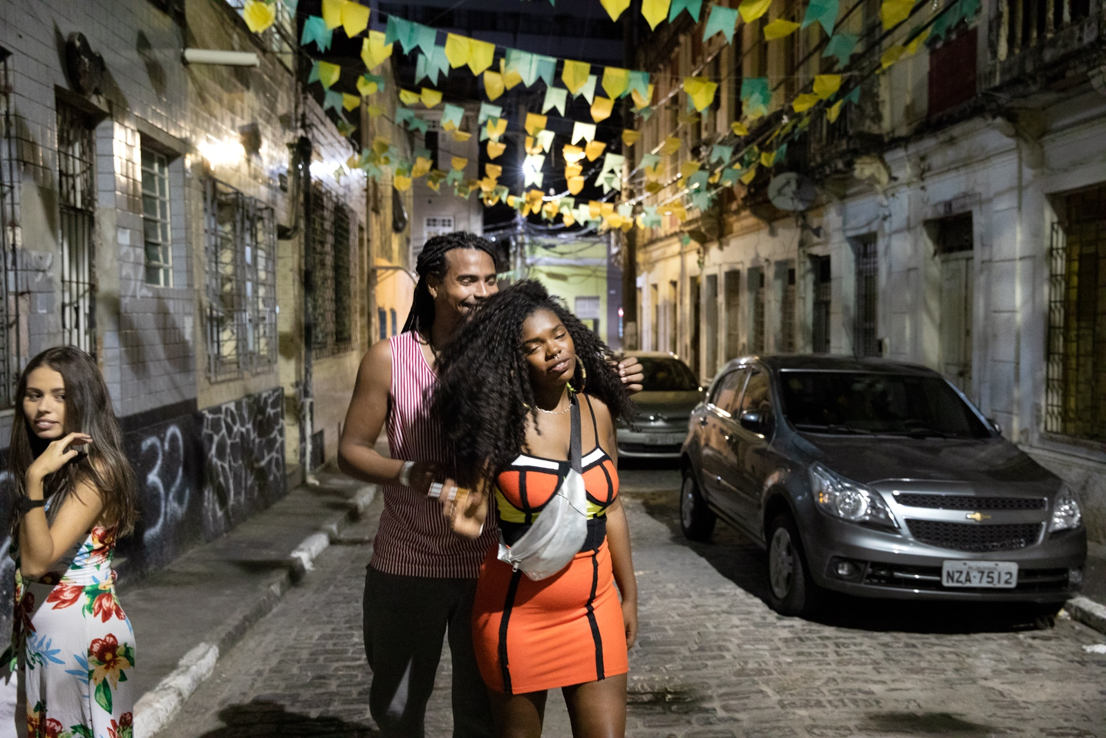 Friends in the streets in front of a Batekoo party in Salvador.
