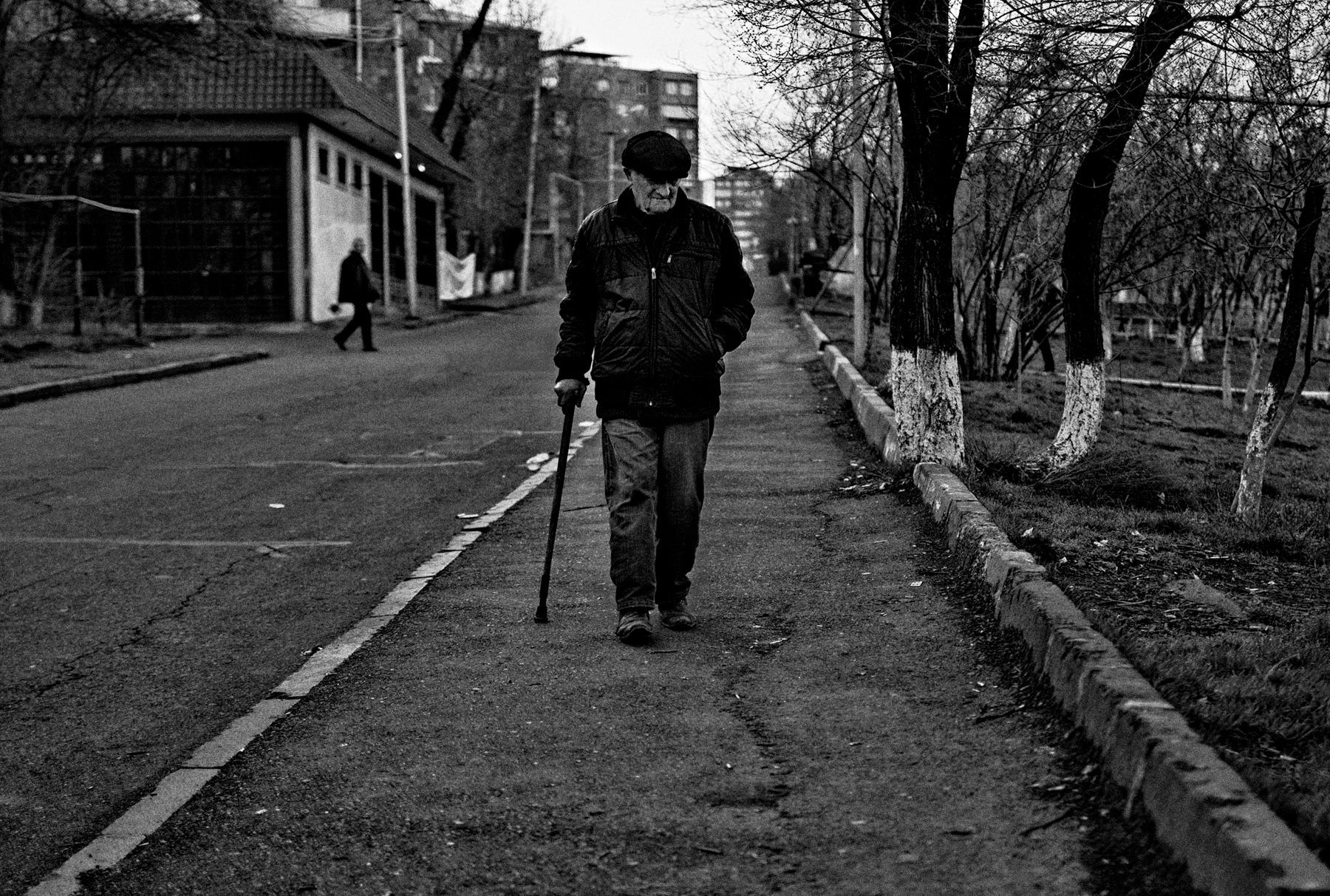 An early morning stroller on the Moldovakan Street in the Capital City of Yerevan, Armenia.