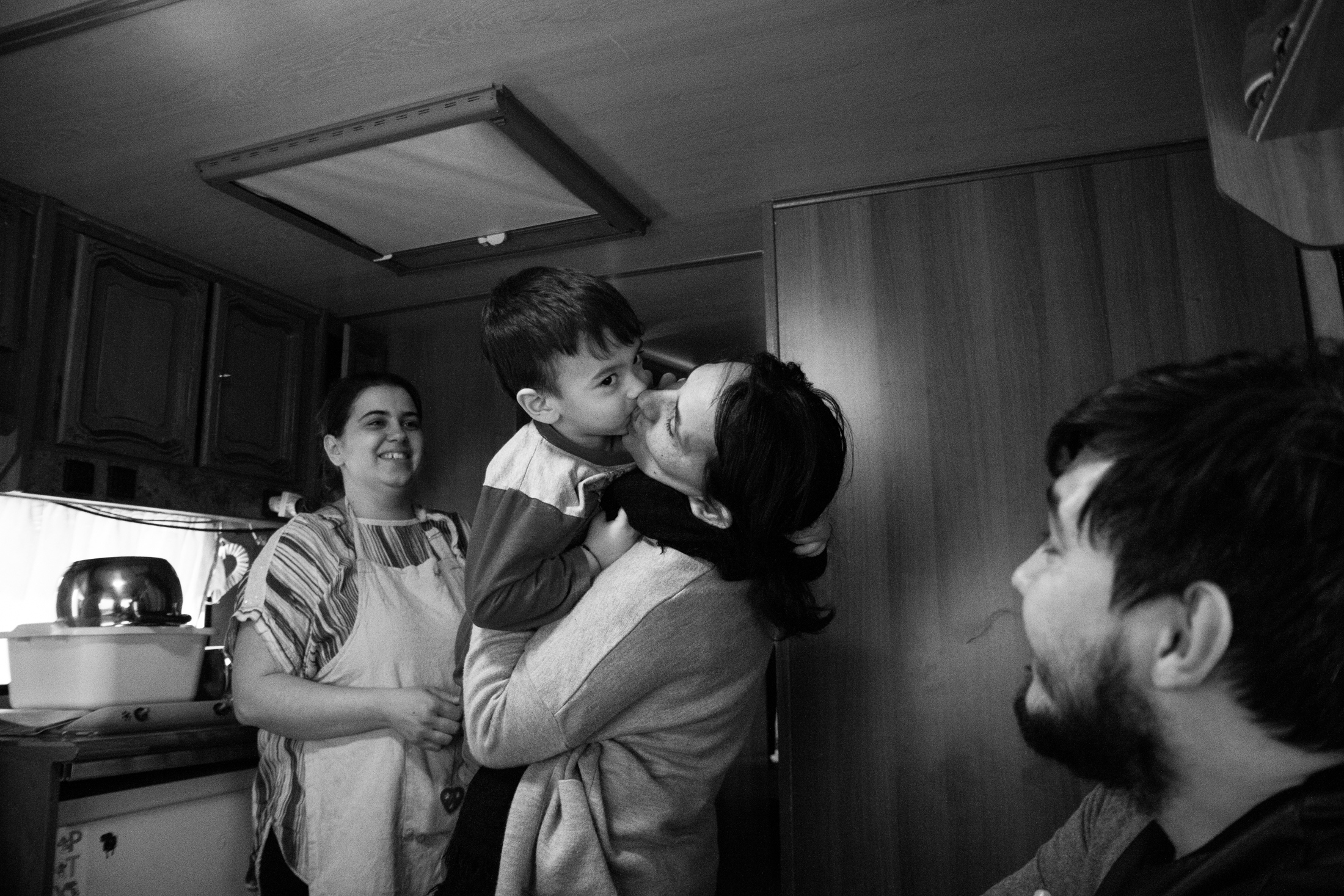 February 2017, nomad camp of Castelnuovo Rangone, Emilia-Romagna, Italy. Moment of joy and intimacy between Linda and the family of one of her daughters inside the mobile home.