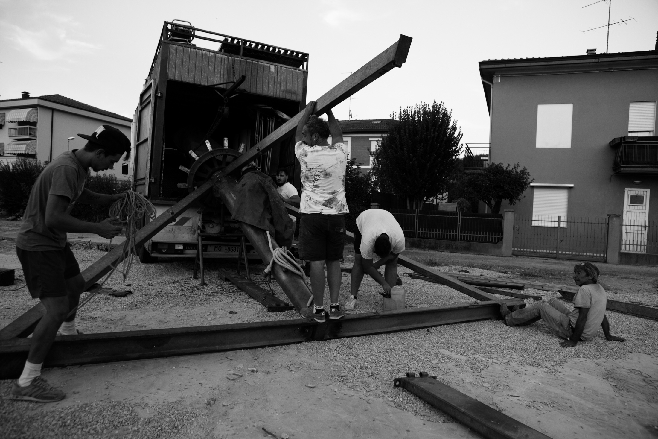 August 2017, Soliera, Emilia-Romagna, Italy. Elix and his brothers work on assembling their carousel, a few days before the country fair. They meet sporadically throughout the year, and fairs are one of those occasions when families can meet to work and spend time together.